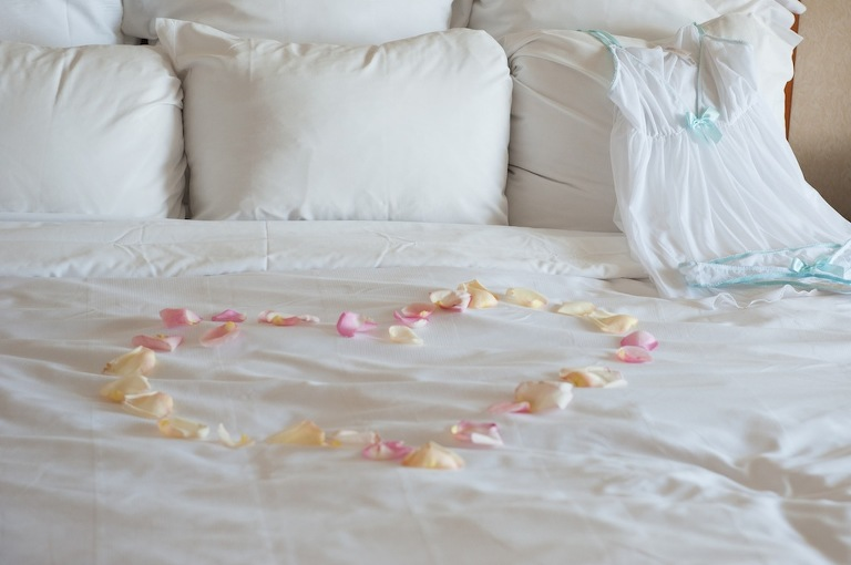 Rose Petals on Bed in Shape of a Heart