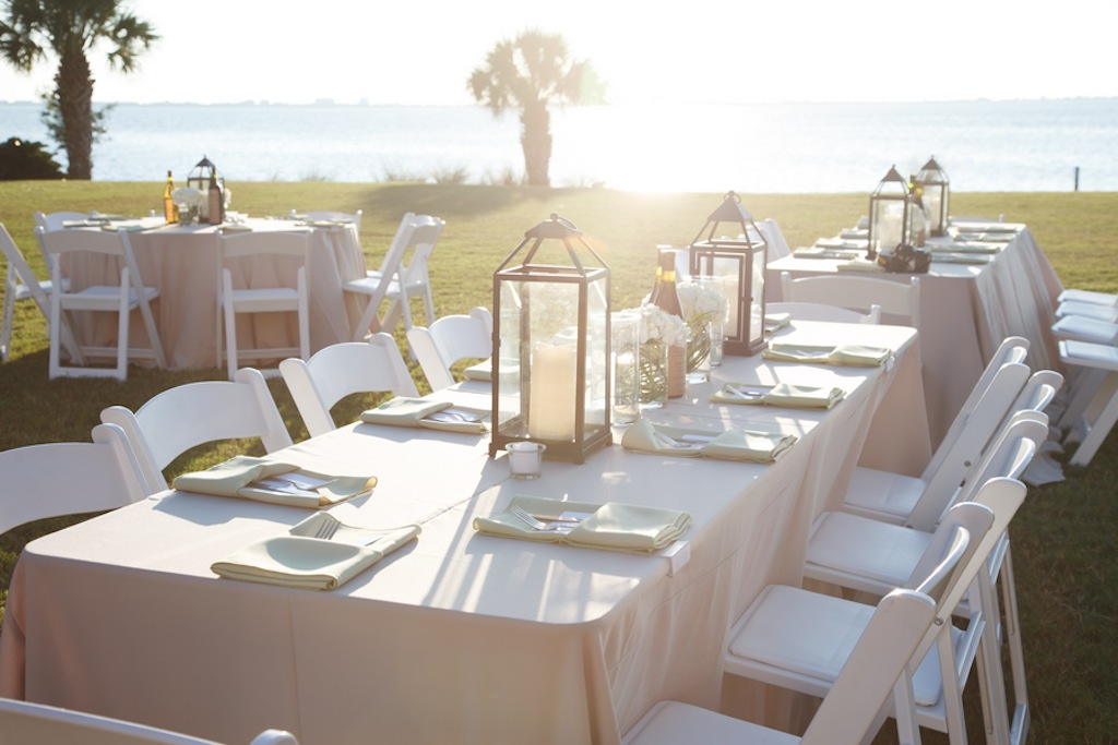 Long Feasting Table with Lantern Centerpieces and Tan-Champagne Linens