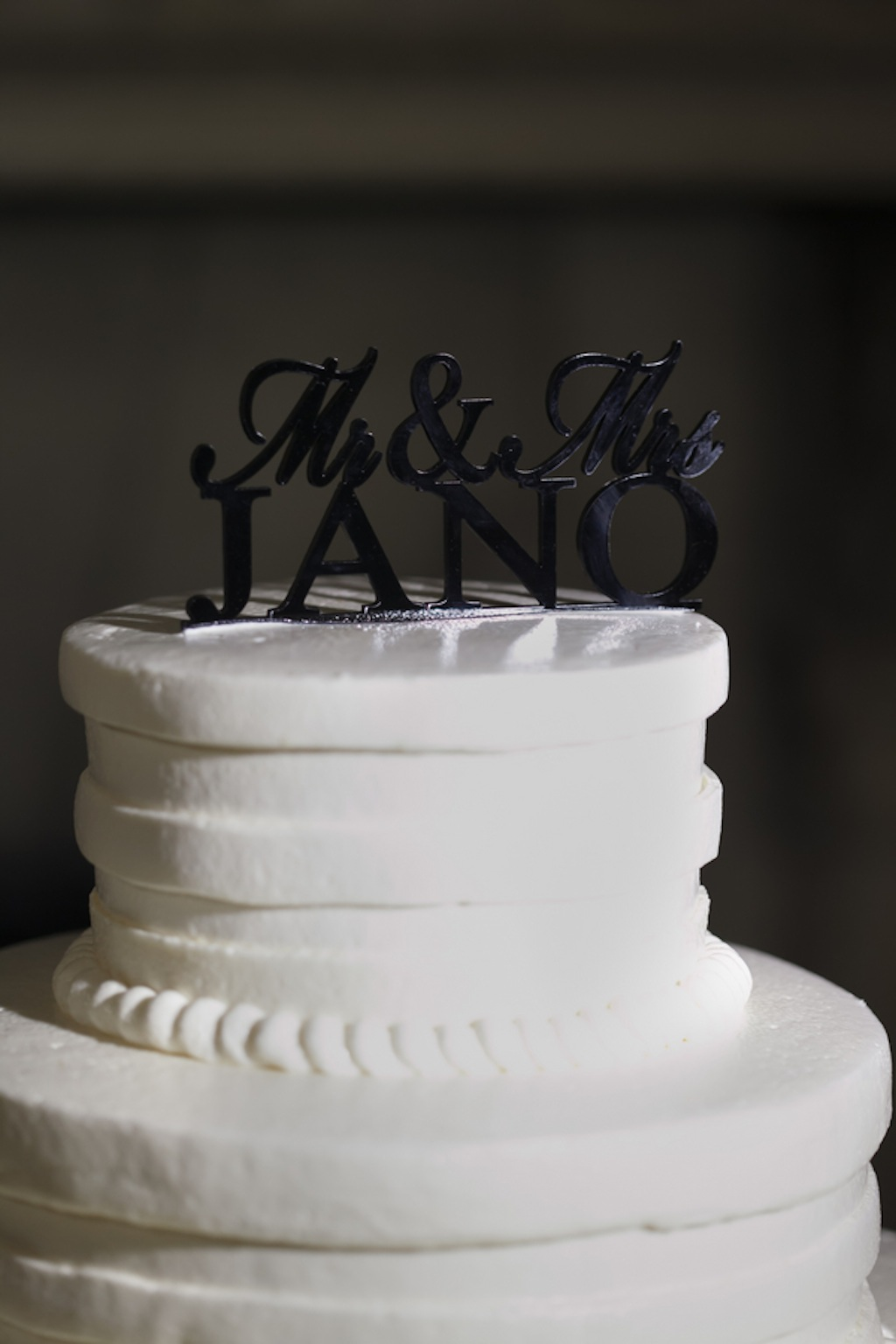 Round, White 3-Tiered Wedding Cake with Last Name Cake Topper