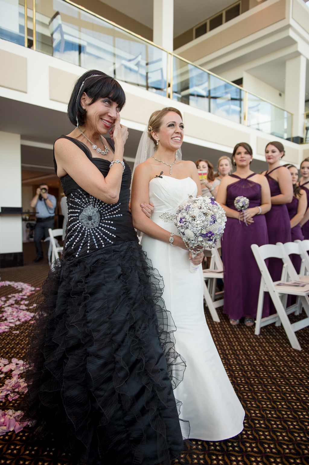 Bride and Mother Walking Down the Aisle