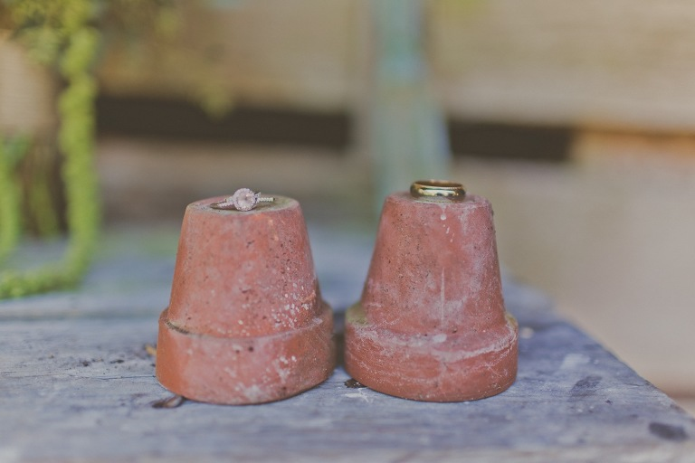 Rustic Wedding Rings on Clay Pots