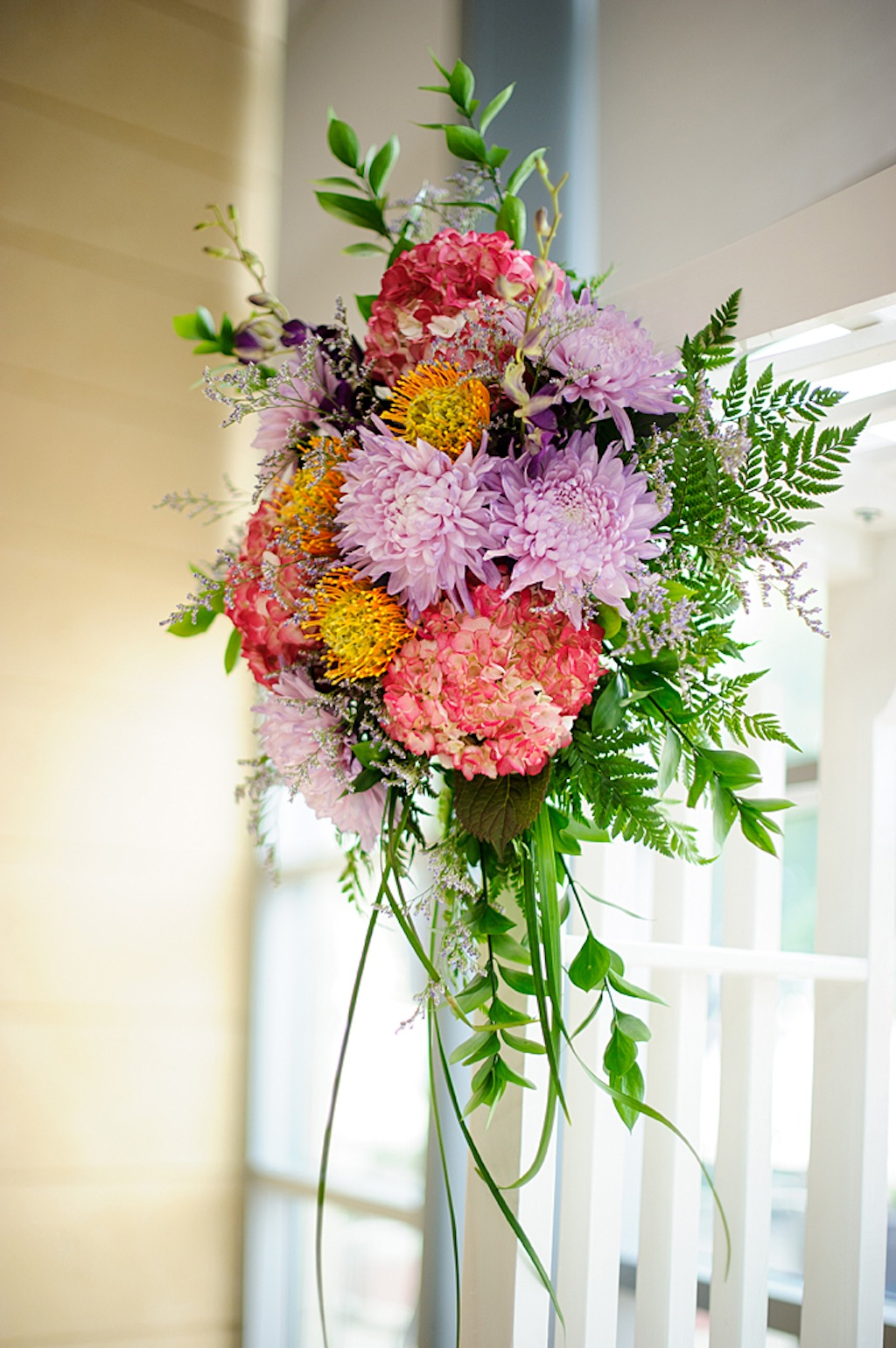 Purple, Coral and Pink Wedding Ceremony Flowers