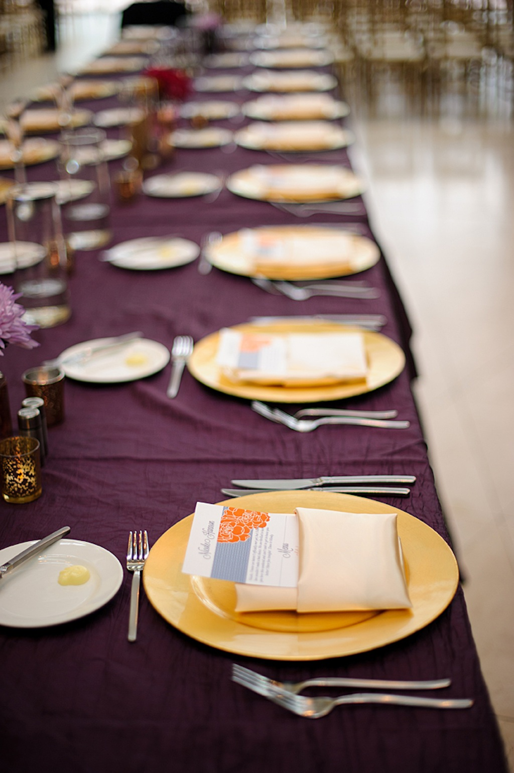 St. Pete Museum of Art Wedding Reception with Purple Linens and Gold Chargers