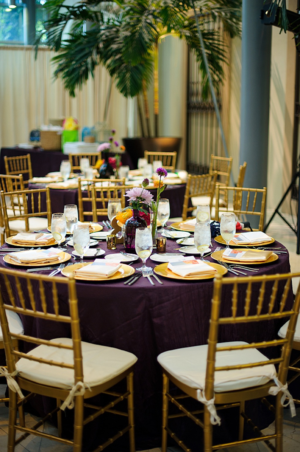 St. Pete Museum of Art Wedding Reception with Purple Linens and Gold Chargers and Gold Chiavari Chairs