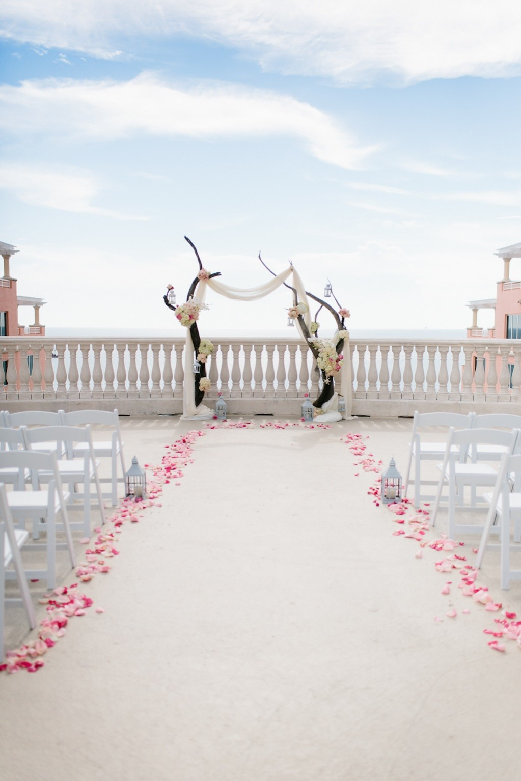 Destination Wedding in Clearwater Beach, FL Pink Flowers and Wood Arch Wedding Ceremony Decor