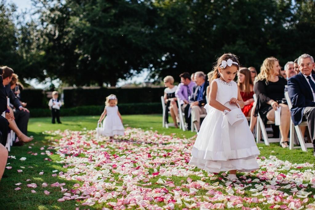 Flower Girls Walking Down Rose Petal Wedding Aisle