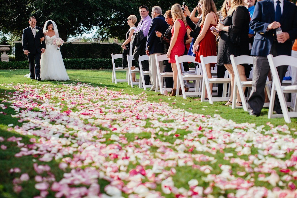 Bride and Father Walking Down Rose Petal Wedding Aisle