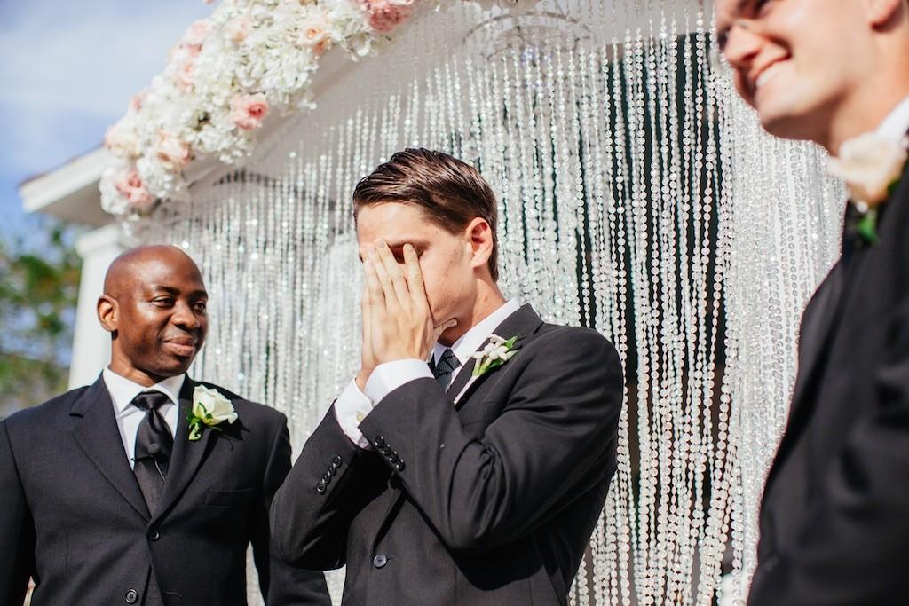 Emotional Groom Seeing Bride Walk Down the Aisle on Wedding Day