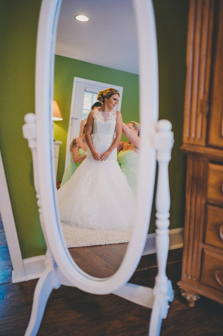 Bride Getting Dressed on Wedding Day