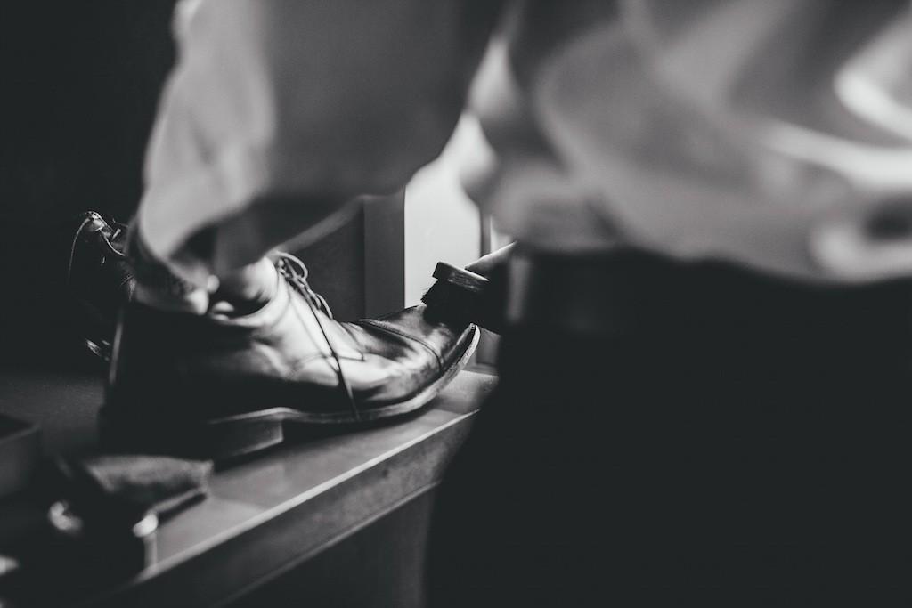 Groom Getting Ready Shining Shoes