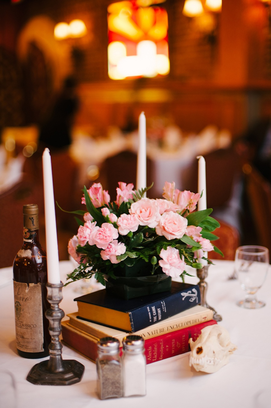 Candle Candelabra Wedding Centerpieces with Vintage Books and Pink Flowers
