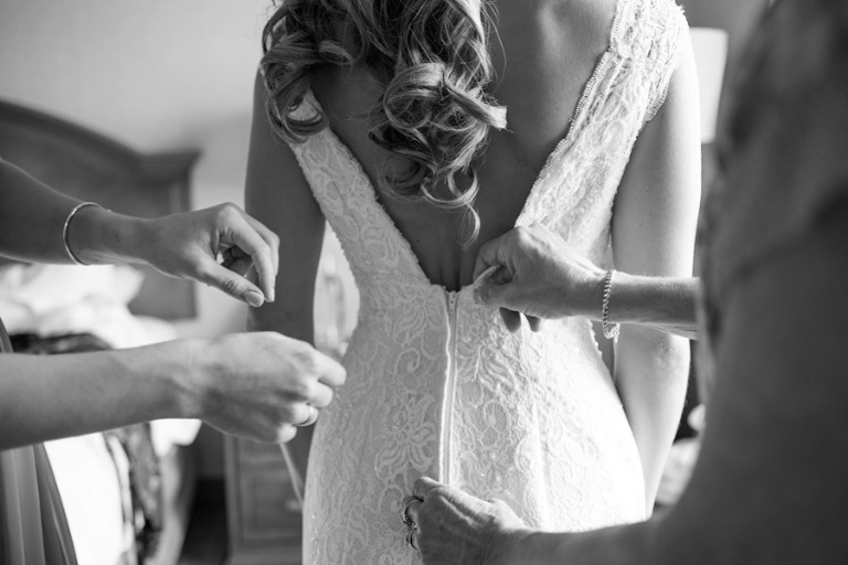 Bride Getting Ready Putting on Dress on Wedding Day