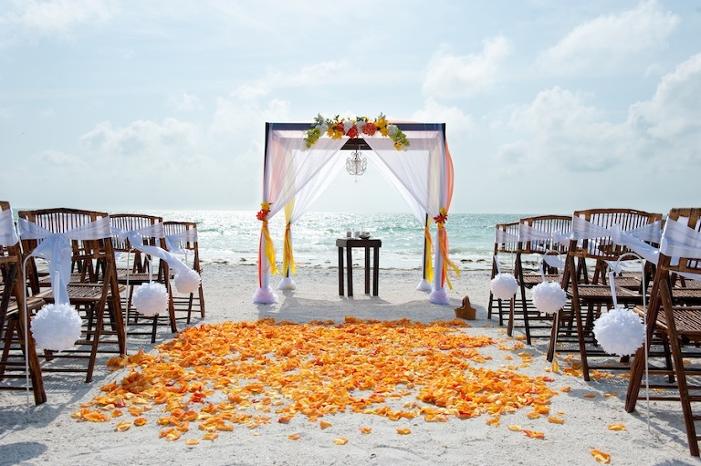 Orange and Red Beach Wedding Ceremony with Wooden Alter and Chandelier | Tide the Knot Beach Weddings