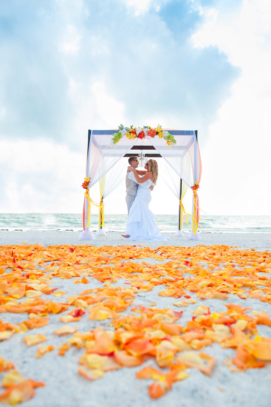 Orange and Red Beach Wedding Ceremony with Wooden Alter and Chandelier   Tide the Knot Beach Weddings