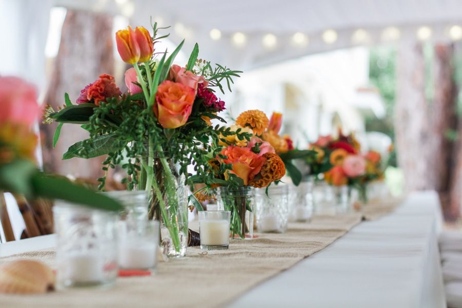 Orange and Pink Wedding Centerpieces | Long Feasting Tables with Burlap Runner