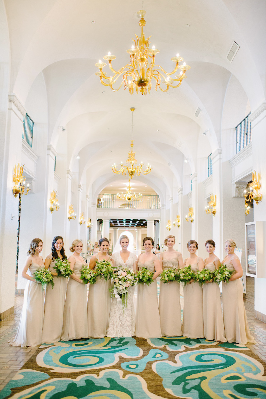 Elegant St. Petersburg Wedding | Champagne Bridesmaid Dresses with Green Bouquets| Exquisite Events Tampa Bay Wedding and Event Planner