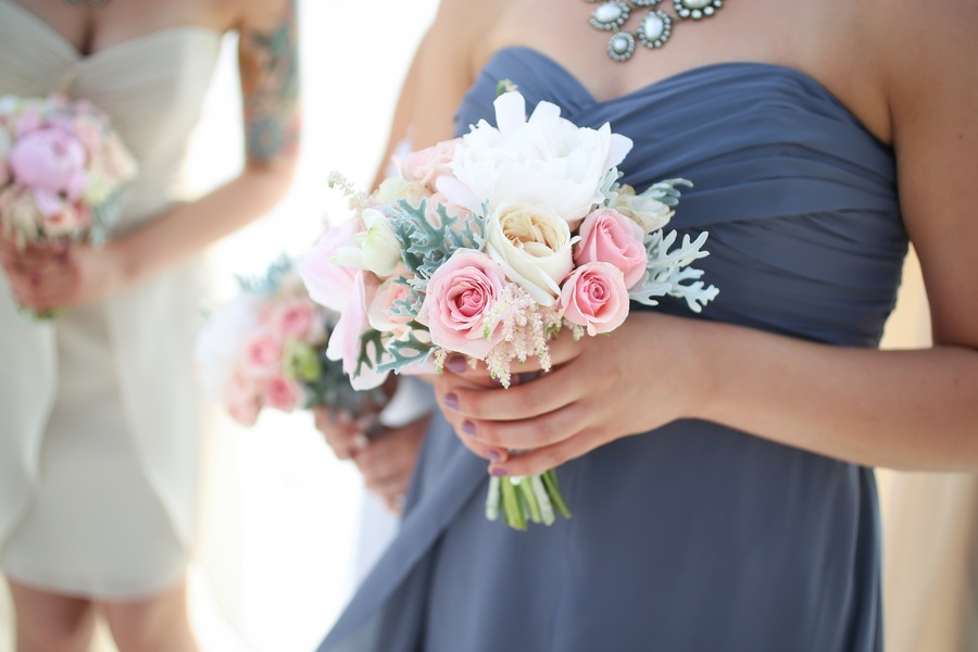 Pastel Pink and White Bridesmaids Bouquet with Purple Bridesmaid Dress