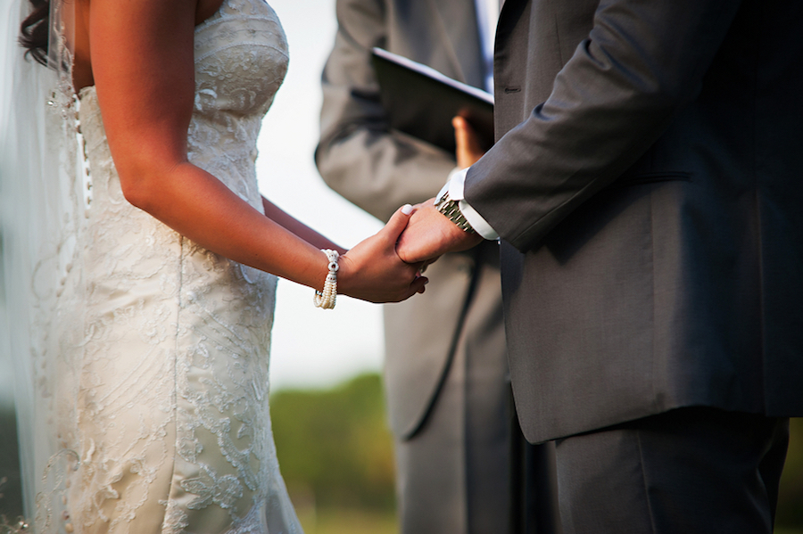 Outdoor Wedding Ceremony, Bride and Groom Holding Hands