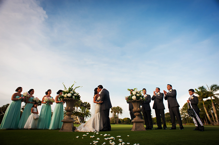 Bride and Groom First Kiss at Outdoor Golf Course Wedding Ceremony | Clearwater Wedding Venue Countryside Country Club