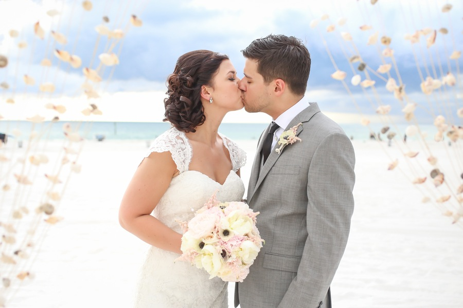 Bride and Groom Clearwater Beach Wedding Ceremony with Hanging Seashells Decor