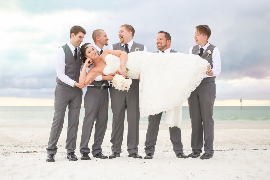 Groomsmen Wearing Grey Suits Holding Bride | Hilton Clearwater Beach Bridal Party Portrait