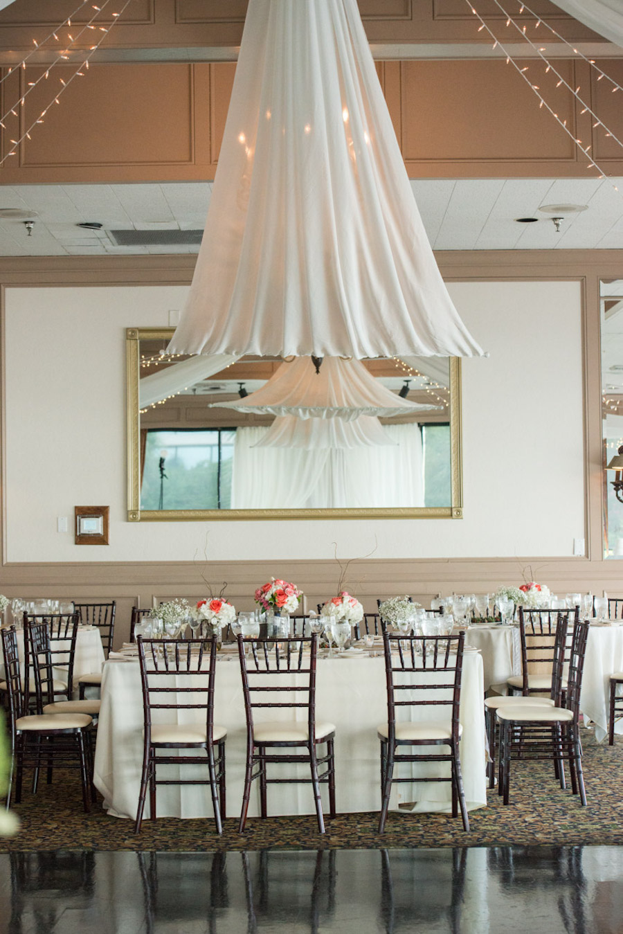 White Wedding Reception Decor with Ceiling Draping and Chiavari Chairs | Tampa Wedding Venue The Rusty Pelican