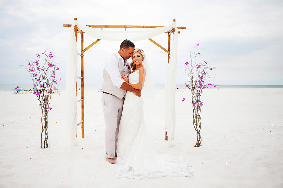 Destination Bride and Groom Beach Wedding Portrait Under Bamboo Altar   Waterfront Wedding Venue Hilton Clearwater Beach   Clearwater Wedding Photographer Limelight Photography
