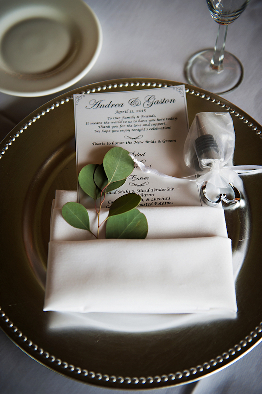 Tuscany Inspired Wedding Reception Silver Charger Place Setting with Menu, Wine Stopper Favor and Greenery