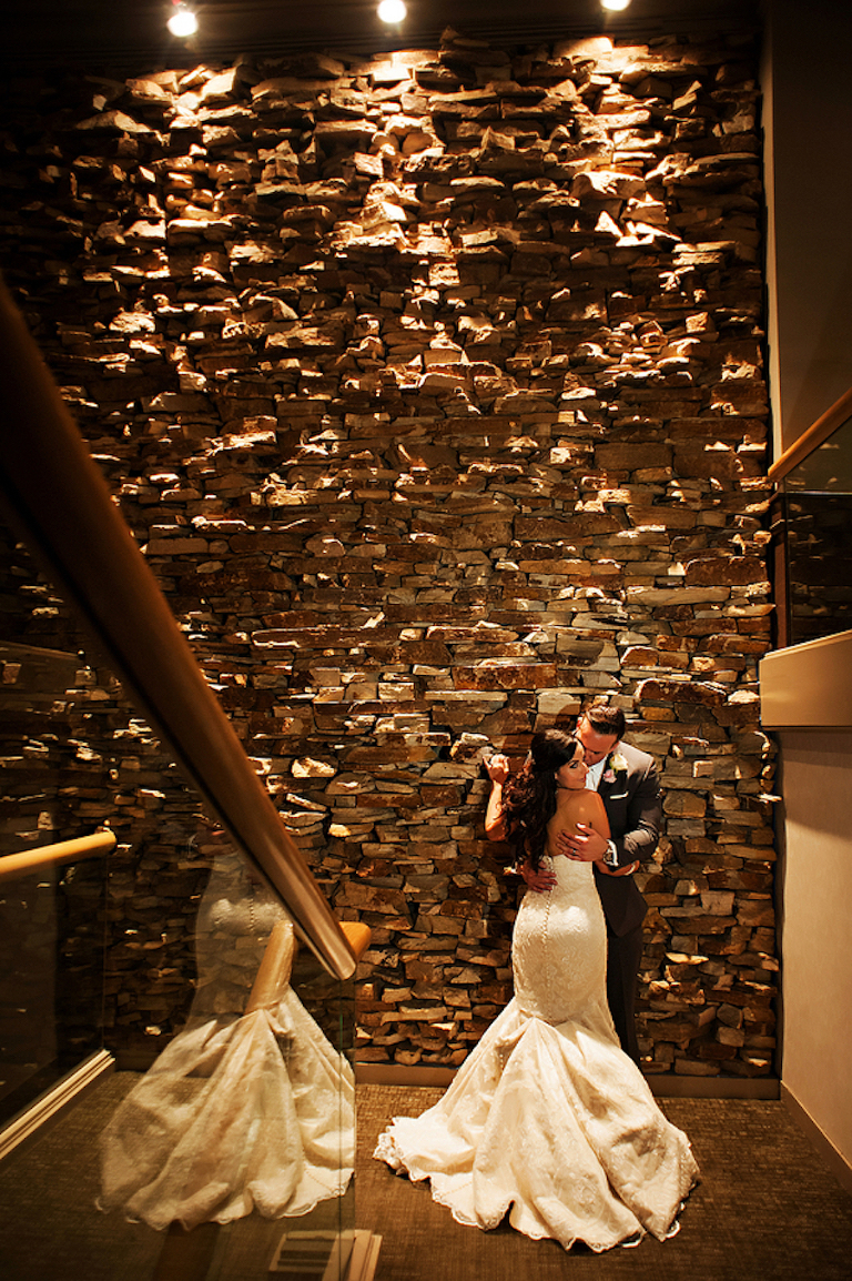 Bride and Groom Wedding Portrait with Rock Wall Background | Clearwater Wedding Venue Countryside Country Club