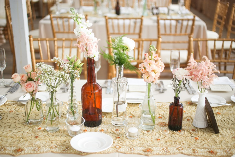 Clearwater Wedding Reception, Blush Pink Wedding Centerpieces with Amber Bottles and Gold Table Runner Linen Details