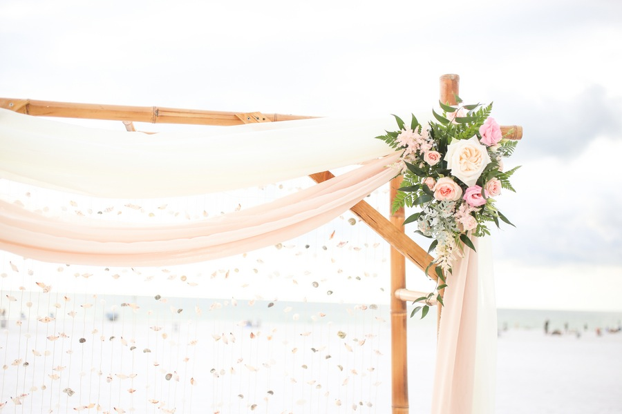 Clearwater Beach Wedding Altar Detail with Pink Draping and Hanging Seashells