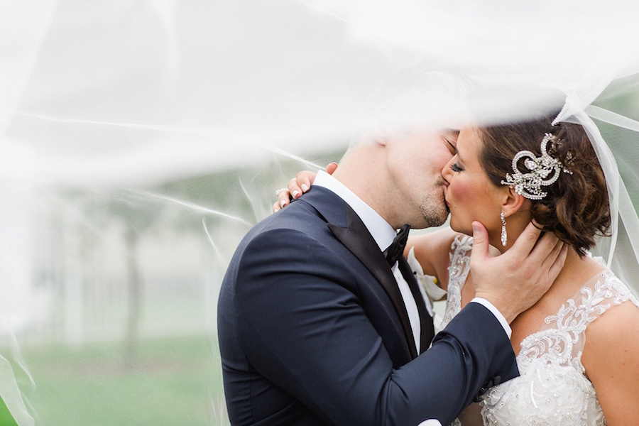 Wedding Day Bride and Groom Kiss | Photos by Tampa Wedding Photographer Ailyn La Torre Photography