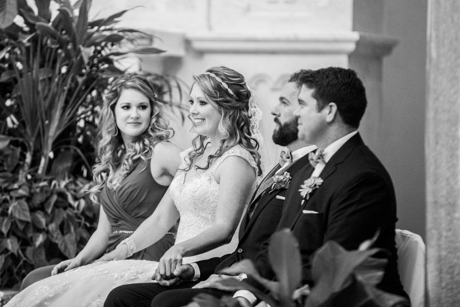 Bride and Groom at Wedding Ceremony Holding Hands | Tampa Ceremony Venue Sacred Heart Catholic Church | Tampa Wedding Photographer Rad Red Creative