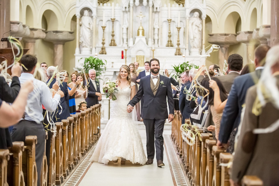 Bride and Groom Walking Down Aisle After Saying I Do | Tampa Ceremony Venue Sacred Heart Church | Tampa Wedding Photographer Rad Red Creative