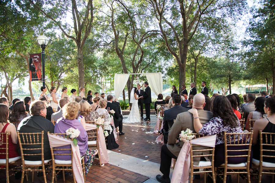 Outdoor Wedding Ceremony Decor with Alter Draping and White and Pink Flowers | Downtown Tampa Wedding Venue The Straz Center
