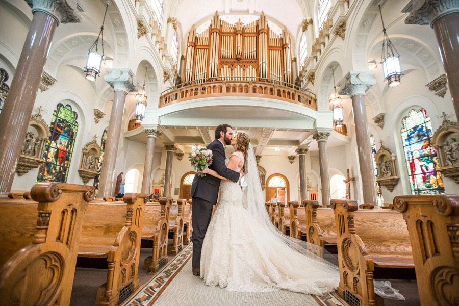 Bride and Groom Kissing Portriat at Tampa Wedding Ceremony Venue Sacred Heart Church |Tampa Wedding Photographer Rad Red Creative