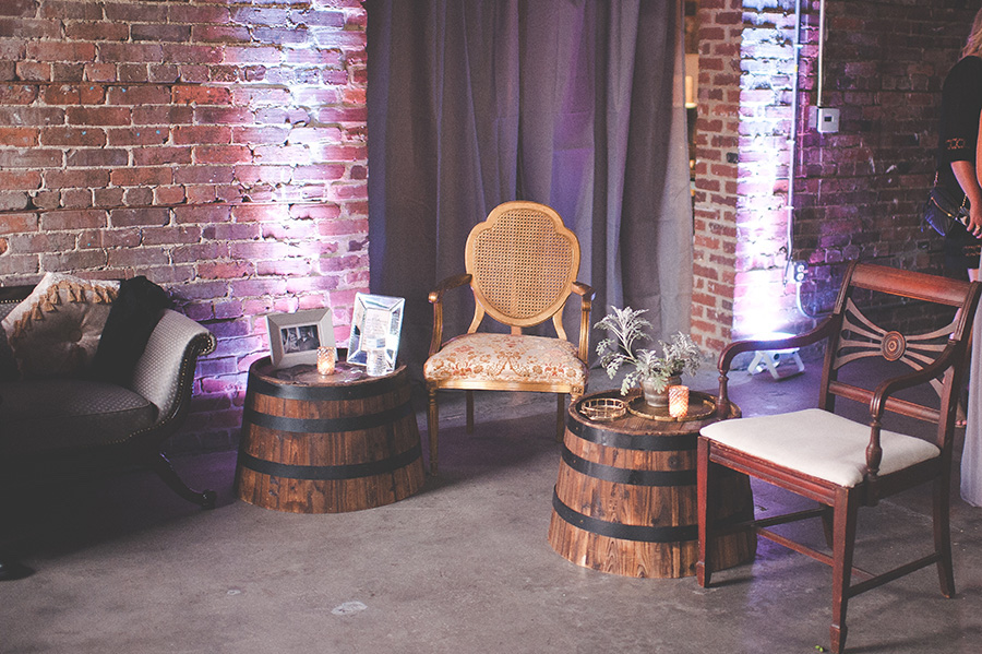 Wedding Reception Vintage Seating Lounge Area with Wooden Barrels   Modern, Unique Exposed Brick Tampa Wedding Venue CL Space in Ybor City