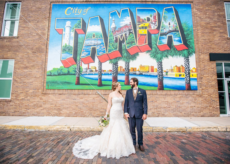 Bride and Groom Wedding Portrait in Front of Tampa Graffiti Sign Downtown | Tampa Wedding Photographer Rad Red Creative