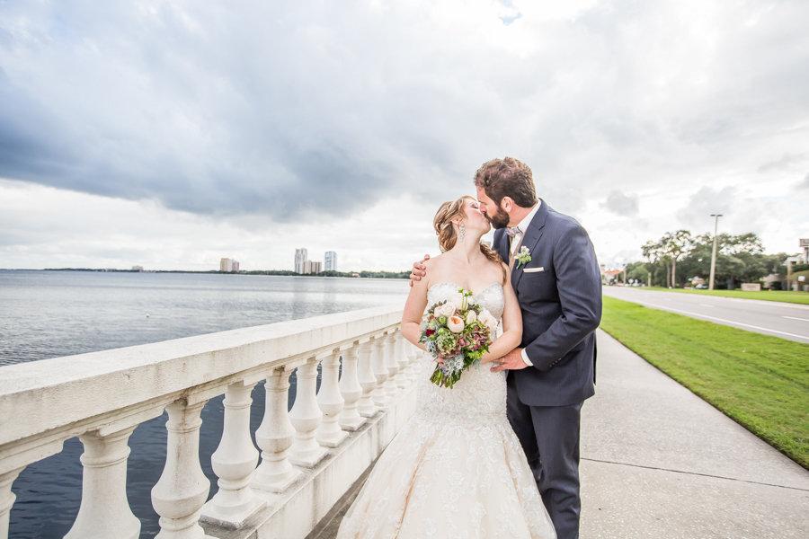 Bride and Groom Kissing on Bayshore Boulevard Wedding Portrait | Tampa Wedding Photographer Rad Red Creative