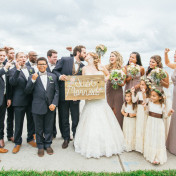 Bridal Party Wedding Portrait Celebrating on Bayshore Boulevard Holding Just Married Sign | Tampa Wedding Photographer Rad Red Creative