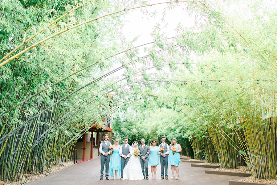 Wedding Bridal Party Portraits with Turquoise Blue Bridesmaid Dresses and Orange Wedding Bouquets   Downtown St. Pete Wedding Venue NOVA 535 Event Space Bamboo Garden