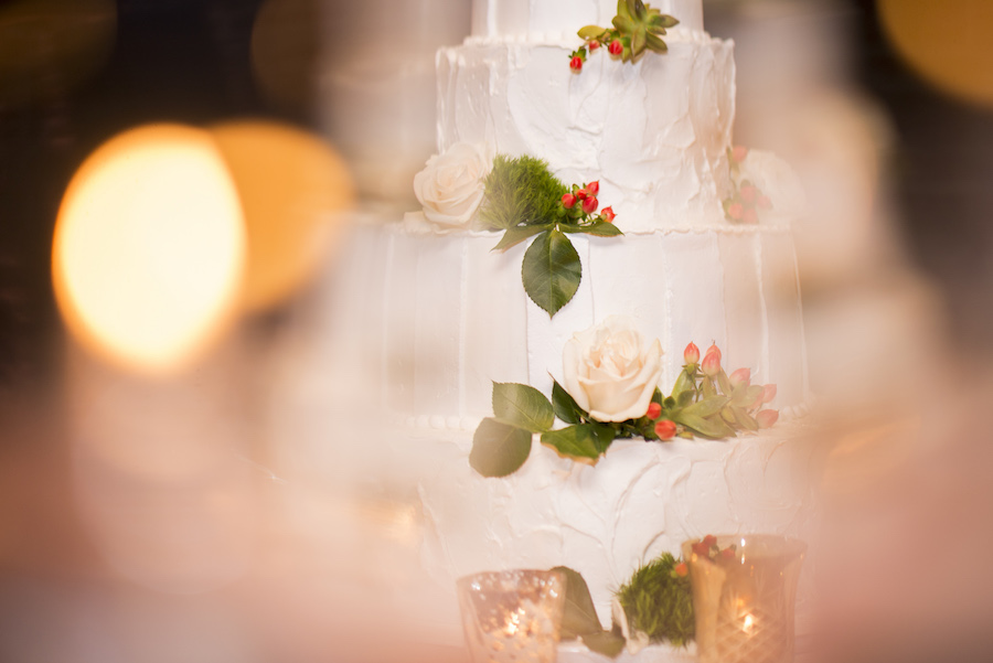 White, Tiered Wedding Cake with White Rose Floral Accents