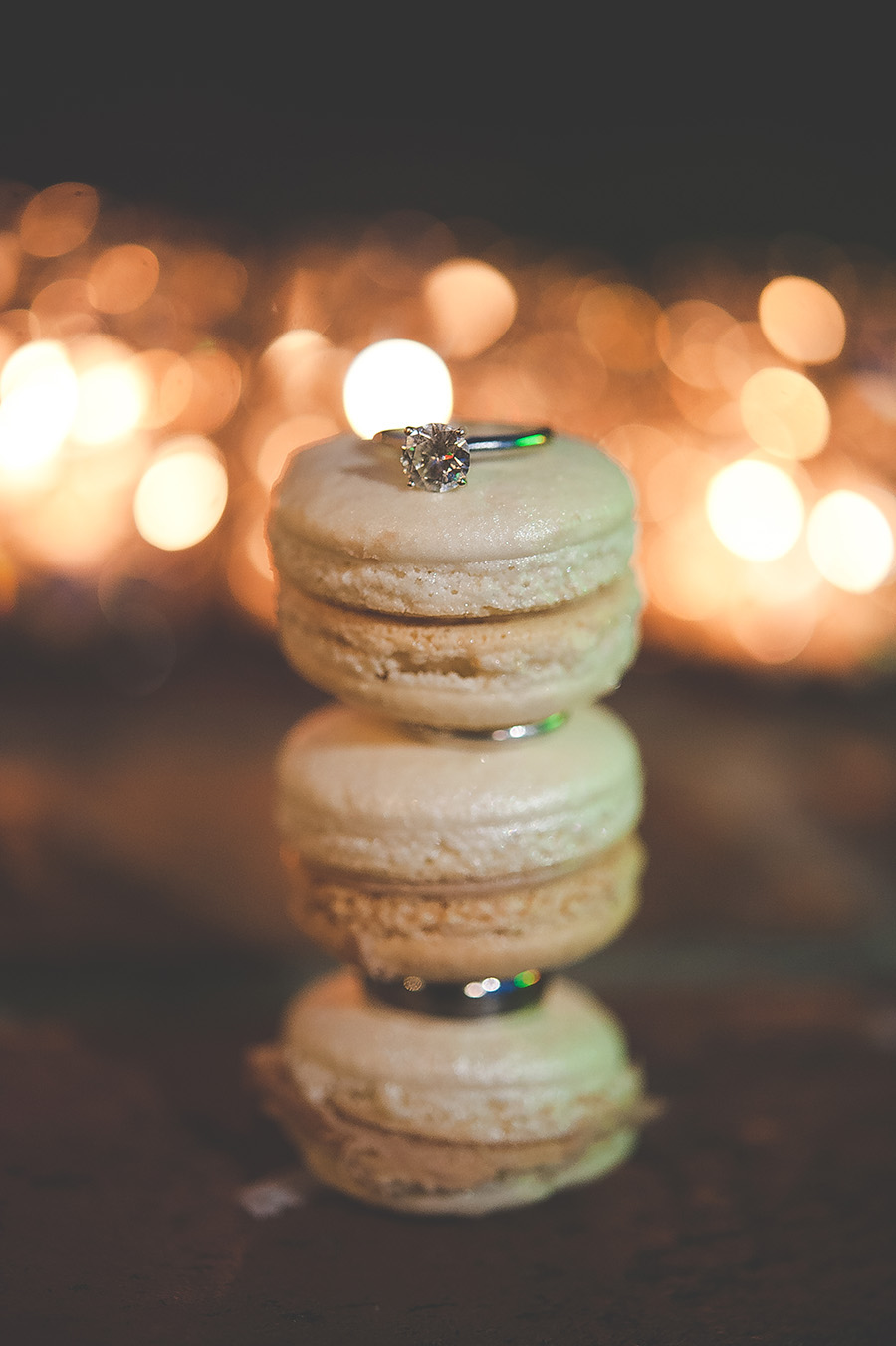 Bride and Groom Wedding Band and Engagement Ring on Macaroons Portrait