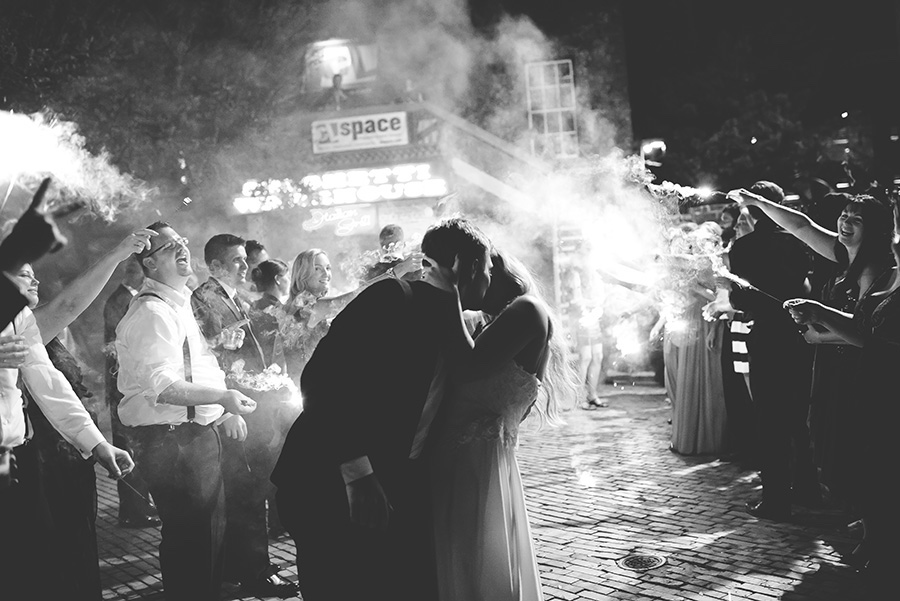 Nighttime. Bride and Groom Sparkler Sendoff with Kiss   Modern, Unique Exposed Brick Tampa Wedding Venue CL Space in Ybor City