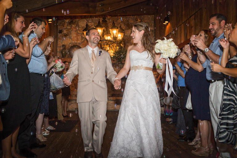 Bride and Groom Wedding Reception Send off Exit with Bubbles | Tampa Wedding Photographer Jeff Mason Photography