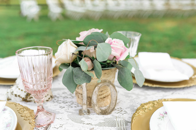 Ever after vintage weddings tampa bay vintage rentals vintage wedding centerpieces with metal table numbers and vintage glassware and chargers tampa wedding rentals junglespirit Gallery