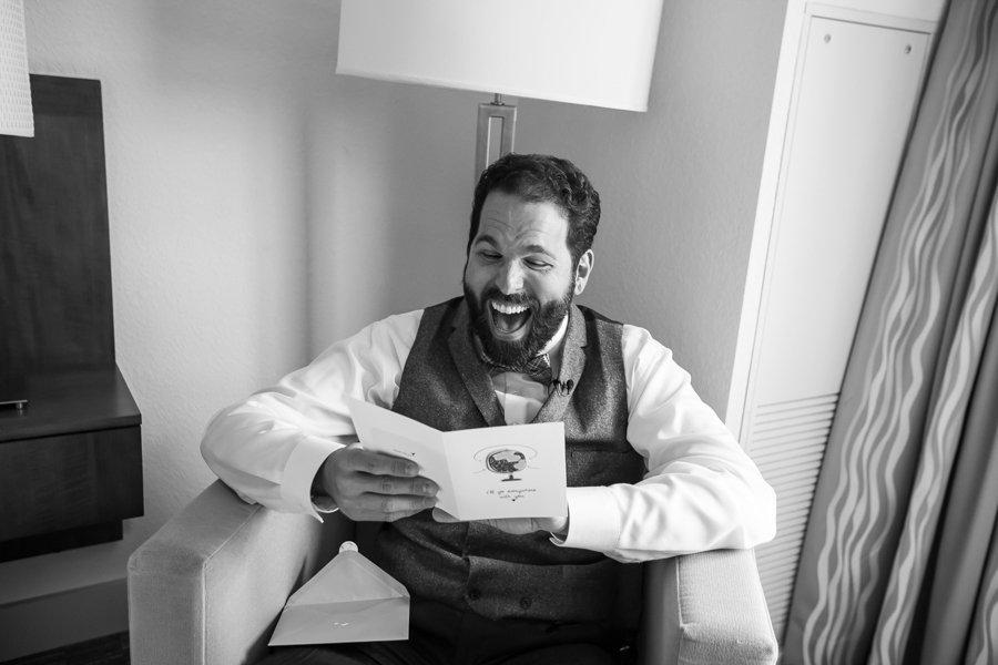 Groom Laughing, Opening Wedding Card