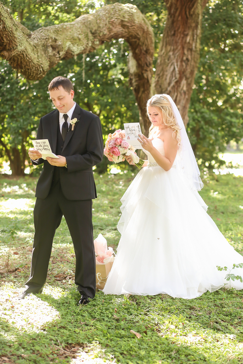 Bride and Groom Reading Wedding Cards during First Look