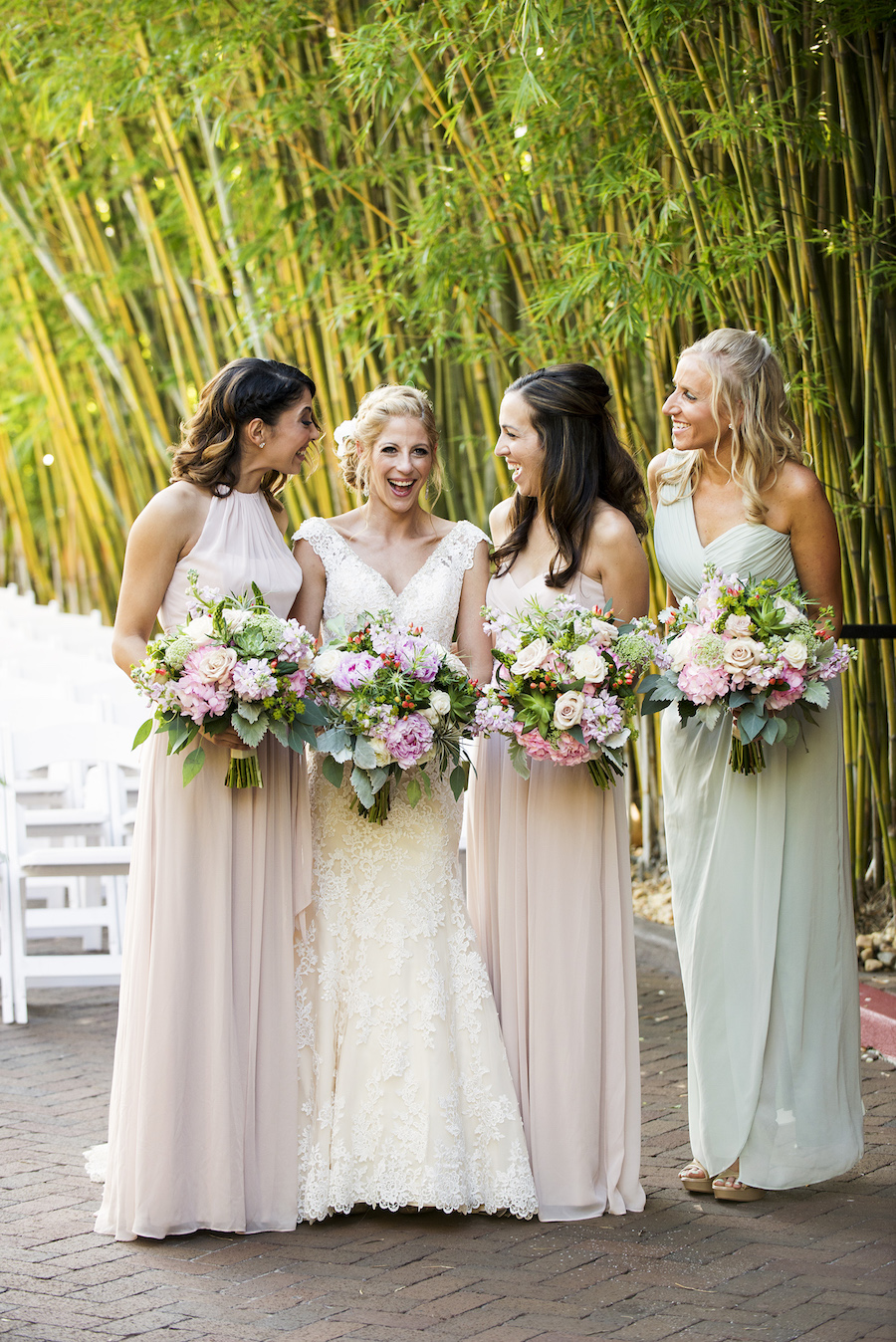 Bride and Bridesmaids Weddin Portriat with Colorful, Pink, Blush, and White Wedding Bouquets and Blush and Mint Green Bridesmaid Dresses