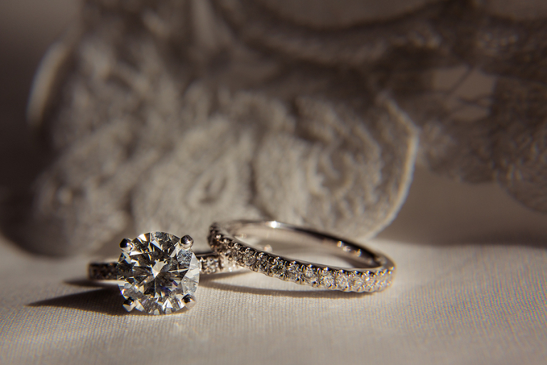 Bride's Round Diamond Engagement Ring and Wedding Band Detail